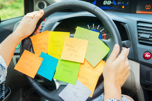 To do list in a car on driving wheel - busy day concept Poster