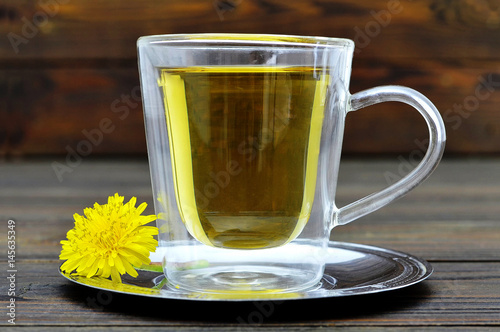 Dandelion tea in the transparent glass cup