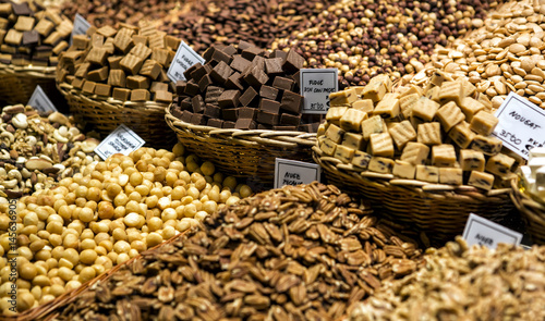 Confectionery at Boqueria market place in Barcelona, Spain. Assorted chocolate candy shop.