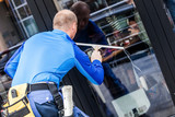 window washer working  at building outdoor - 145644177