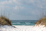 A path through the sand dunes leading to the beach. © tputman151