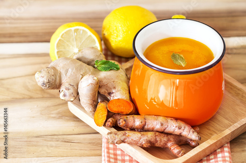 a cup of Turmeric Tea with lemon and ginger , Benefits for reduce Inflammation , Poster