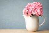 the sweet hydrangea flowers in white vase