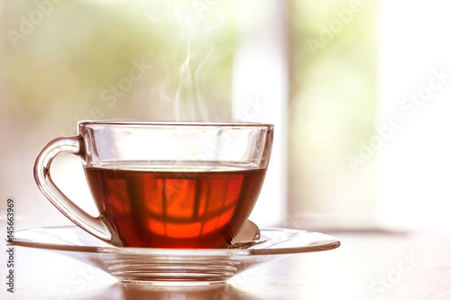 Papiers peints The Close up warm black tea cup on wooden table in living room , relax with tea time concept