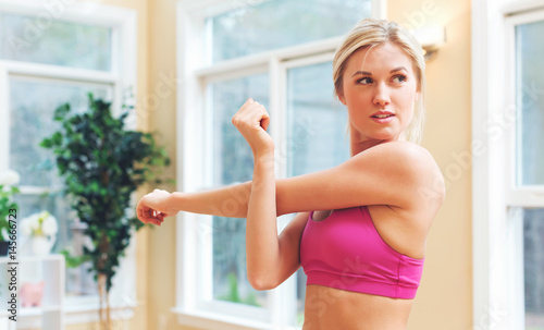 Fit healthy young woman doing stretches
