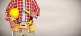 Fototapeta Builder handyman with construction tools.