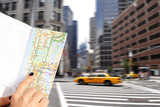Tourist using a city map from the guide, on the street, Manhattan, New York