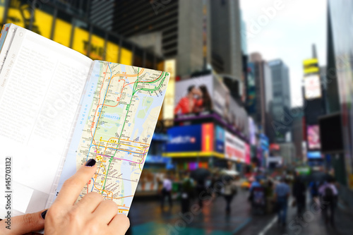 Woman hand holding a tourist map in Manhattan, New York city center
