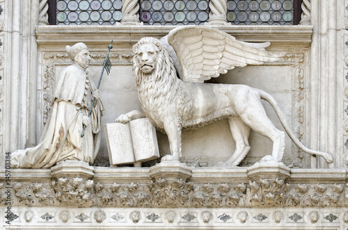 Detail of the Porta della Carta entrance to the Doge's Palace in Venice, Italy, depicting Doge Francesco Foscari kneeling before the Lion of St Poster