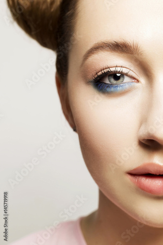 Juliste Portrait of  beautiful woman with blue make up on eyes and blue glitter in hair