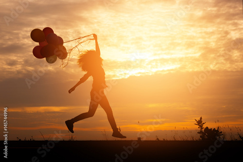 Silhouette woman with balloons in hand Poster