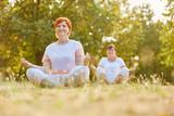 Senior women making yoga in the park