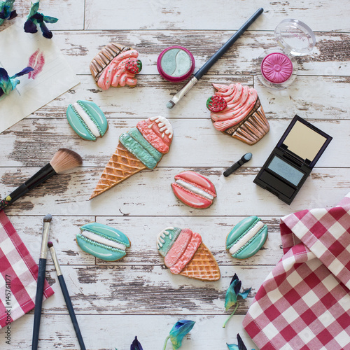 gingerbread in the form of ice cream and macaron on wooden background
