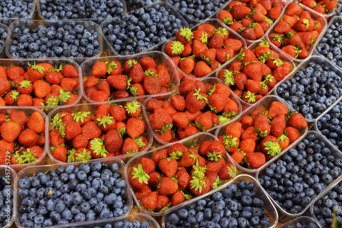 ripe berries in a plastic container in the store