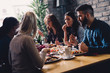 Group of happy business people eating in restaurant - 145799721