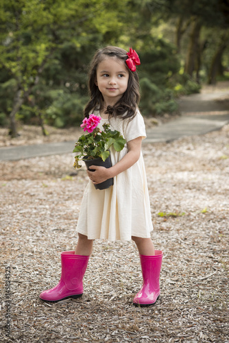 Little Hispanic girl with flowers Poster