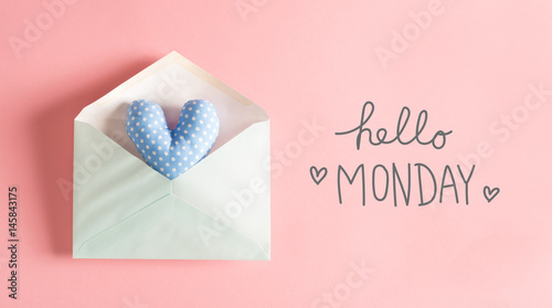 Hello Monday message with a blue heart cushion