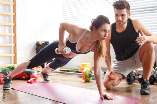 Poster Woman during workout with trainer