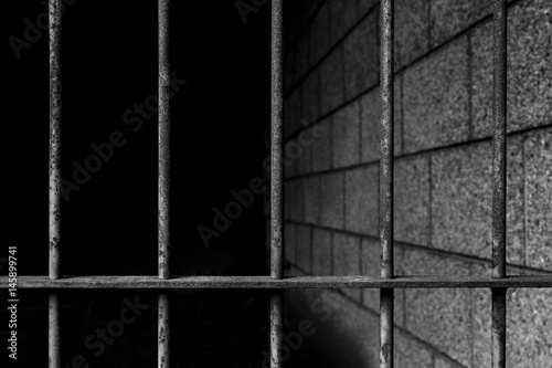 old prison bars cell lock background dark black and light Poster