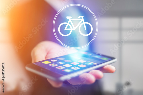 Bicycle icon over device - Sport and technology concept