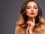 Fototapety Studio Portrait of Beautiful Model with Volume Shiny Wavy Hair. Fashion Make Up and Curly Ombre Hair. Close up