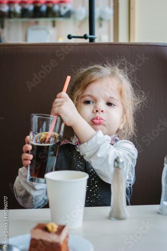 Girl drinks cola Poster