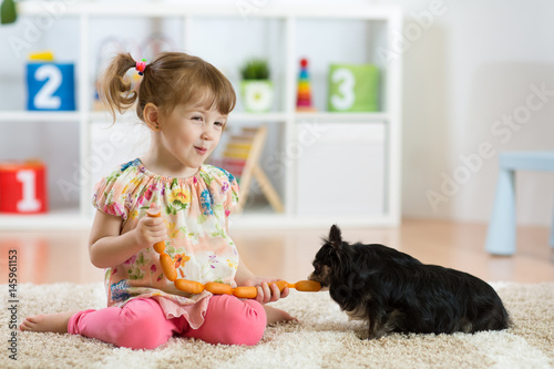 Poster child feeding dog