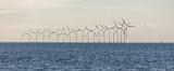 Panorama of Offshore Wind Yurbines in cloudy weather in Copenhagen, Denmark.