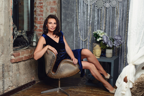 Poster Seductive woman 50 years old posing in photo studio