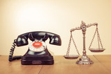 Law scales and retro telephone on table - 146002127