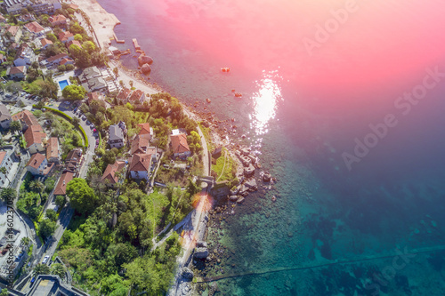 Foto op Aluminium Lichtroze Top view of the resort town and the sea in the sunlight