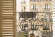 Balcony with decorative railing and shutter  in Paris, France
