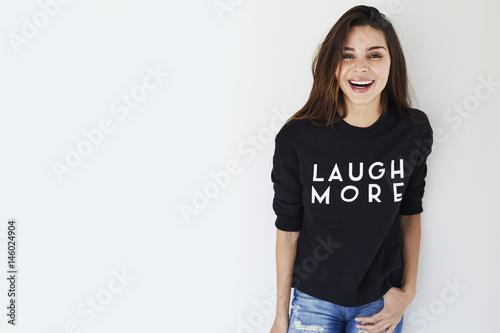 Laughing brunette in slogan sweatshirt, portrait