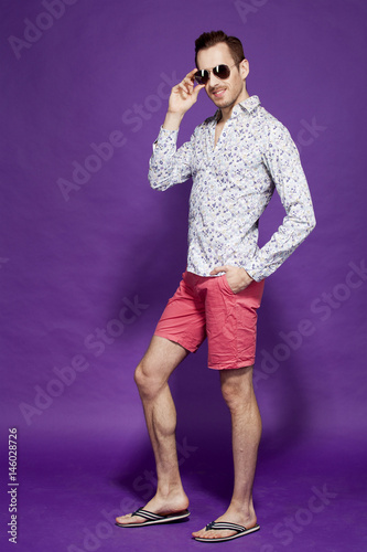 Poster guy with glasses on a purple background
