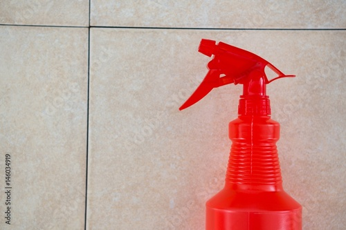 Close up red spray bottle