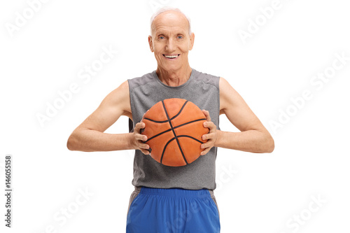Senior with a basketball looking at the camera and smiling Poster