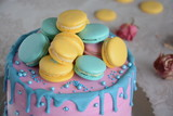 Homemade pink colorful cake with macarons