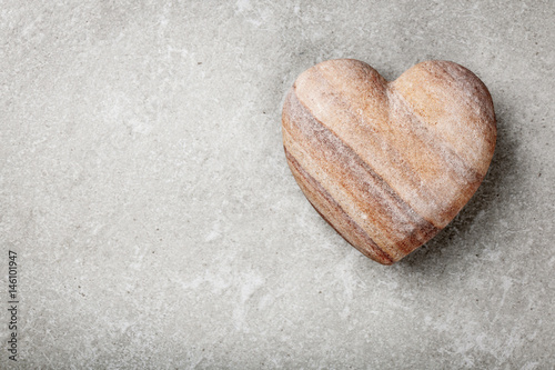 Stone heart on gray background Poster