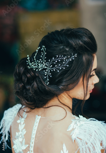 Fotobehang Kapsalon Elegant brunette bride sitting back with collected hair. Tender wedding stylish hairstyle with accessories.