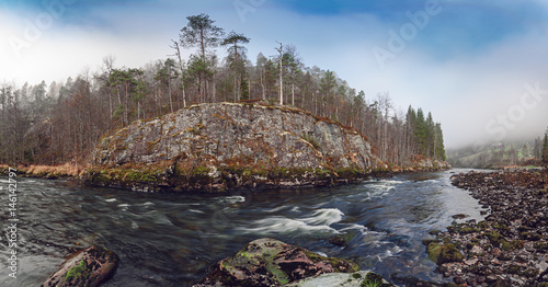 Papiers peints Cappuccino Norwegian landscape with mountain river flow. Autumn forest and mossy rocks around.