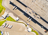 Aerial view of warehouse with trucks. Industrial background. Logistics from above.  - 146159510