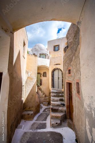 Narrow neighborhood at the old traditional village of Emporio, Santorini, Greece.