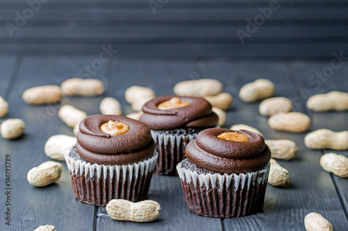 Chocolate cupcakes filled with peanut butter and topped with chocolate mousse Poster