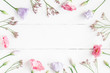 Flowers composition. Frame made of various flowers on white wooden background. Flat lay, top view - 146206173