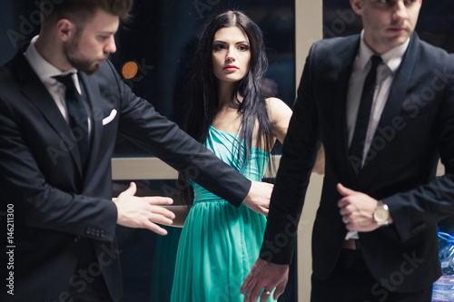 Beautiful female celebrity with bodyguards