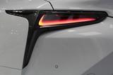 Rear LED lights of a modern japan exlusive car, parking sensor visible