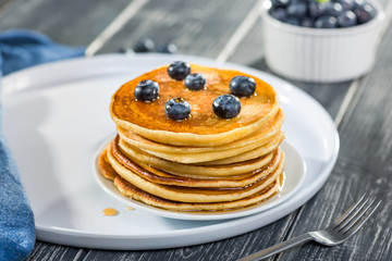 Pancakes  with fresh blueberries and maple syrup, close up