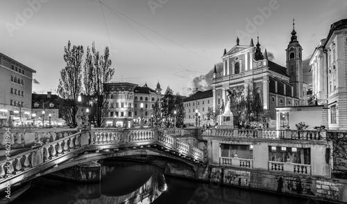 Foto op Plexiglas New York TAXI Romantic Ljubljana's city center in black and white: river Ljubljanica, Triple Bridge - Tromostovje, Preseren square and Franciscan Church of the Annunciation. Ljubljana, Slovenia, Europe.