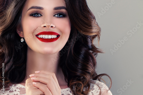 Smiling Model Woman with Cute Healthy Smile. Pretty Face Closeup