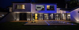 View of modern villa with pool in the night - 146249358